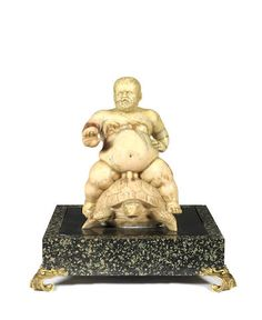 An Italian 19th century Jaune de Sienne marble group of the naked dwarf Morgante riding a turtle after the 'fontanella del Nano Morgante'.