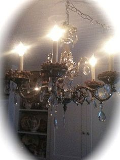 Love chandeliers in the kitchen!....in the bathroom!....in the bedroom!...in the living room!