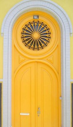 cheery yellow front door with an awesome round window