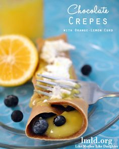 Chocolate Crepes with a delicious orange-lemon curd filling. This would make a great breakfast or dessert!