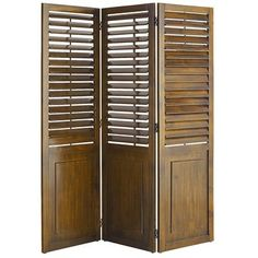 Think plantation shutters are just for windows? Our three-panel, hinged Plantation Shutter Room Divider says otherwise. Well-crafted and stained a deep brown, it features raised paneling and adjustable louvers for classic architectural appeal. It's perfect for separating rooms, hiding clutter or adding interest to your decor.