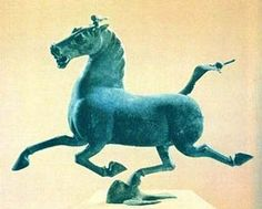 """Bronze statuette of a horse discovered in a tomb of a Han Dynasty general. The only hoof that's touching the ground is treading a swallow symbolizing the speed of this horse; one of the """"Heavenly Horses"""" of the West coveted by the Chinese."""