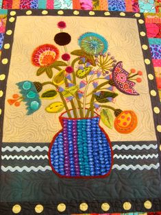 Sue Spargo quilt, wool floral applique, spotted at Precious Time