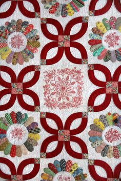 """close up,  """"Dresden Delight"""", 2013 raffle quilt at Westside Quilters Guild (Oregon).  Vintage hand pieced Dresden plate blocks with redwork; wedding ring arcs shaped as flowers.  Design by Jean Gordon."""