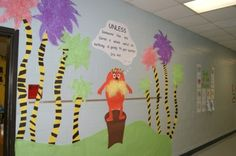 Heather Melton designed this cutesy Lorax-inspired wall display. We love that she used Easter grass to create the truffula trees and the Lorax's mustache – it adds visual interest and a cool 3D effect!