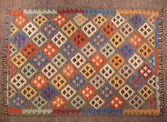 This hand made kilim rug is flat woven in a tapestry weave and made entirely of wool. It is woven by Uzbek weavers in central Afghanistan near the city of Maima