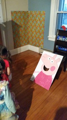 Peppa Pig Birthday game. Cut a whole for Peppa's mouth and throw small balls into her mouth.