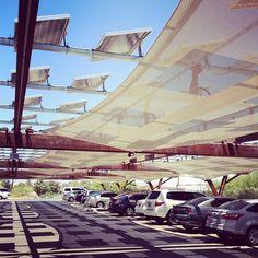covered parking with solar panels via @happymundane on Instagram