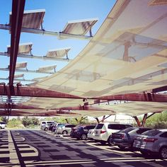 covered parking with solar panels via @happymundane on Instagram