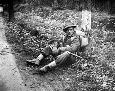 """"""" Private N.J. Ingram, Perth Regiment of the Canadian Army, stops for a rest north of Arnhem during the liberation of Holland, the Netherlands, 15 April 1945. Pin by Paolo Marzioli"""