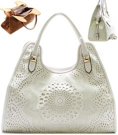 I want one of these in every color. laser cut leatherette satchel purse