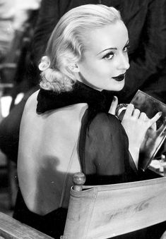 """I've lived by a man's code designed to fit a man's world, yet at the same time I never forget that a woman's first job is to choose the right shade of lipstick."" - Carole Lombard"