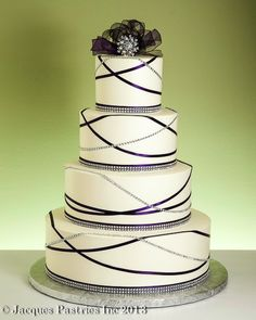 Garland Bling Cake from http://www.jacquespastries.com/weddingcakes/classic/classic.html