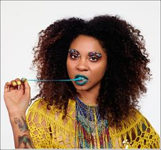 Teal lips and turquoise gum = FUN! From Illamasqua.