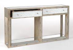 Cette console drapier miroir a un style art deco revisité avec des miroirs piqués et une patine beige vieillie.