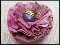 Embellish a lapel, headband, scarf, belt or hat with this one-of-a-kind, flower brooch, accented with repurposed jewelry ~ Handmade by Kristines Art Wear.   Your brooch will arrive in a pretty organza bag perfect for gift giving!  For more fashion accessories visit my Etsy store at https://www.etsy.com/shop/KristinesArtWear or email KristinesArtWear@icloud.com
