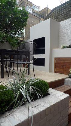 bespoke outdoor BBQ kitchen fireplace cupboards travertine cream paving balham clapham dulwich wimbledon garden designer london