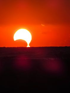 The November 3, 2013 partial solar eclipse is seemingly dripping into the ocean, as seen from Sullivan's Island, South Carolina. Credit and ...