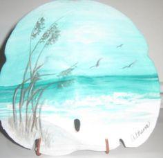 Pretty coastal scene painted on sand dollar. Seashell Painting, Seashell Art, Seashell Crafts, Stone Painting, Rock Painting, Seashell Ornaments, Painting On Shells, Snowman Ornaments, Ocean Crafts