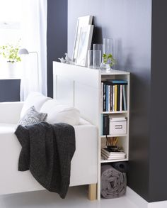 A headboard that can also be used as a sofa/storage table? That's BRIMNES! Bonus- the top shelf has holes for electrical cords; perfect for lighting or charging a mobile phone.