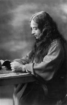 This is Paramahansa Yogananda  reading. I heard that the original was taken during a train ride. One can read more about Paramahansa Yogananda here --http://en.wikipedia.org/wiki/Paramahansa_Yogananda -- and here -- http://en.wikipedia.org/wiki/Autobiography_of_a_Yogi
