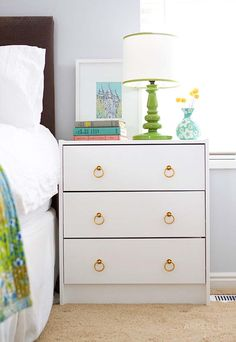 white paint and knobs make bedside table