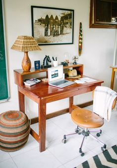 """This Beautiful Ugandan Home Comes With An Equally Amazing Love Story #refinery29  http://www.refinery29.com/kampala-uganda-house-tour#slide-8  """"My office is a super eclectic mix of things that make the space bright and pleasant to work in. I purchased the mugavu wood desk from an expat couple who were moving back to the States. The lamp was handmade by a local carpentry workshop and the shade was handwoven out of raffia; I found the pouf at a local craft shop in Kampala and fell in love with…"""