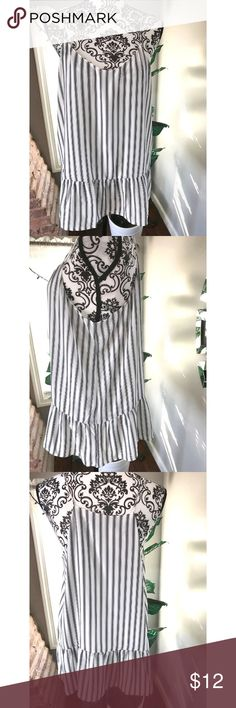 Women spaghetti strap shirt Women spaghetti strap shirt. Size large. No rips or stains. In great condition. It has alittle  peplum/flare at the bottom to add some fun to an outfit. Its stripped with black and white colors.  Non smoking home Tops