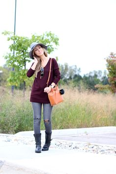 Love the merlot sweater, gold pendant necklace, and flat moto boots