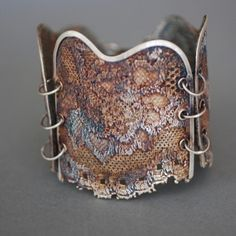 Bracelet | Dorian Grabowski.  Sterling silver, cotton lace, stained and sealed.