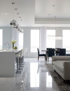Today open-plan interiors are super trendy because they enlarge your space and create a whole zone for communicating and having fun. If you aren't ready for a whole loft-like space, you can try just to unite the kitchen and the living room. Here are some tips to do that right. Define the size of each...