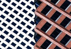"""Ripped, 2014. """"The angled top floors of this dark red office building in New Orleans, Louisiana, provide an interesting collage with the white building a few blocks down the street,"""" says Olic. Combining the two is a simple photographic idea of a structure ripped into two distinct parts."""""""