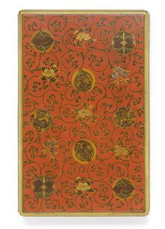 A red lacquer rectangular suzuribako (writing box) and cover Late Edo Period, early 19th century  The exterior decorated in gold, silver and iroe hiramakie and togidashi with stylised confronted butterfly, crane and ho-o roundels, sprays of peony and cherry interspersed among karakusa, the inside of the lid with crickets among windswept Autumnal plants and flowers, the drops of dew on the pampas grasses discreetly inlaid in silver.