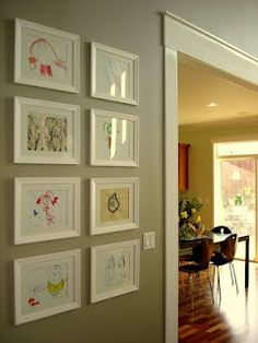 Cheap frames used to hang childrens' artwork. The kids would love to have an art gallery like this in the Family room to show off!