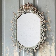 Metal filigree wall mirror.  Product: MirrorConstruction Material: Metal and mirrored glassColor: Distressed greenDimensions: 21.5 H x 17 W