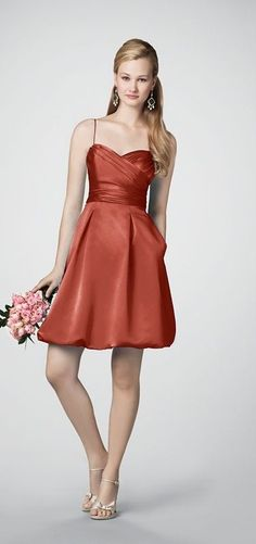 I'm thinking this is the winner...my girls need straps cause they all have boobies (unlike this poor girl!) Burnt orange bridesmaid dress!
