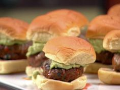 Rachael's Chorizo Sliders are loaded with a combination of ground pork and Spanish chorizo, and are finished off with a layer of shredded cheese and an avocado cream sauce.