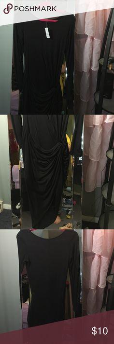 Black asymmetrical dress with side knot Black skin tight dress with a side knot right at the hip & asymmetrical cut Joyce Leslie Dresses Midi