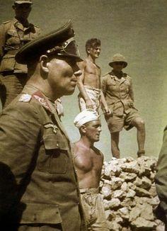 THE DESERT FOX Field Marshal Erwin Rommel standing beside members of his Afrika Korps, N. Africa. Date taken: 1942.