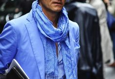 Toni Tanfani is the owner of Gisa, a boutique in Ancona, Italy.  His style is sophisticated and pared back, almost rakish.  He wears scarves well too, such as the bright blue one pictured, which is great to see in men.