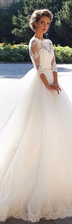 This dress is simply beautiful! I love the 3/4 sleeve and the sheer netting on the arms and chest