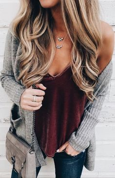 Gray cardigan over burgundy velvet top and blue jeans. #winterfashion2017casual