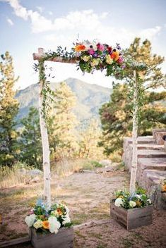 Simple birch altar to be tied to red gate at beach. Tulle draped over top