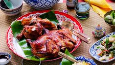 Grilled chicken (gai yaang) | Gai yaang is a popular street food originally from Thailand's Isaan region, but now found throughout the country. In this recipe, the chicken is refrigerated overnight in a simple marinade, and then grilled the next day.