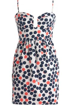 Gumball Party Dress: Features removable spaghetti straps for optional strapless wear, sweetheart neckline with grooved dip at center bust, sleek contrast stitching to the bodice, colorful retro polka dot print throughout, and a slightly bubbled skirt to finish.