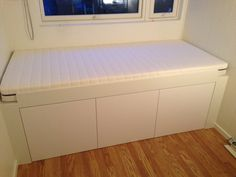 IKEA Hackers: mount a single cupboard sideways and add foam cut to size as mattress or cushions - for seating or extra daybed