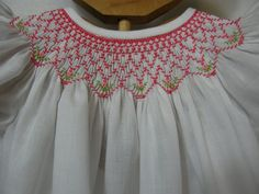 3 to 6 month hand smocked Bishop dress; white cotton batiste with bright carnation smocking