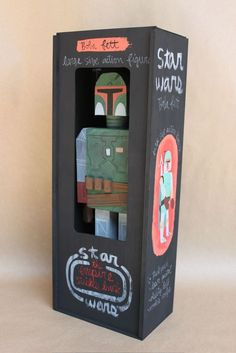 Packaging for Amanda Visell's wooden Darth Vader and Boba Fett.