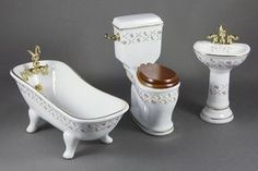 """A three-piece bathroom set by Reutter Porcelain featuring a gold crosshatch pattern, including a sink, tub, and toilet. 1/12"""" scale"""