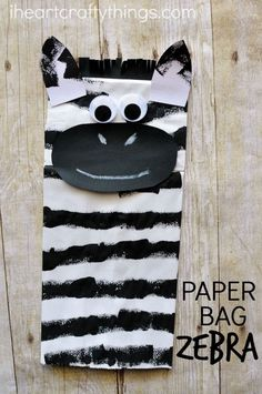 This paper bag zebra craft is great for a letter Z alphabet craft or after visiting the zoo. Using foam curlers to print the stripes onto your zebra is extra fun. Great zoo craft, animal craft and summer kids craft.